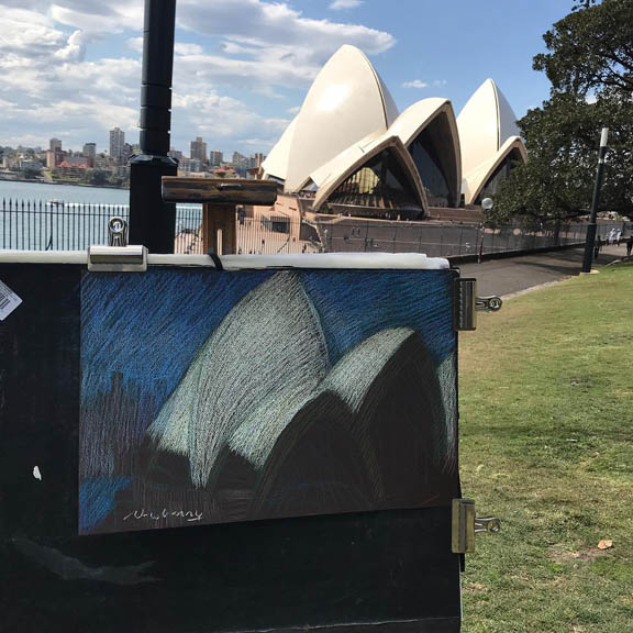 Newberry, drawing the Sydney Opera House pastel on black paper